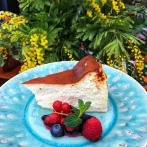 blue plate with dessert and strawberry