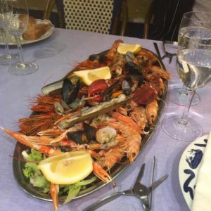 seafood platter with a glass of white wine
